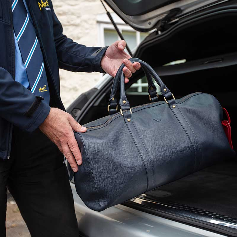 airport transfers driver packing the boot marks airport transfers